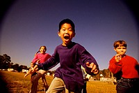 Group of children running in a park
