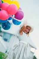 Portrait of a girl holding balloons