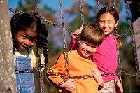 Portrait of girls and a boy on a jungle gym