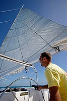 Man sailing a catamaran in Key West, Florida. December 2004