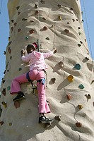 Climbing wall, Black female, challenge. Greater Miami Mardi Gras, Bayfront Park, Miami. Florida. USA.
