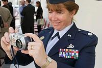 Female, military, digital camera. Collins Avenue Victory Garden, South Beach, Miami Beach, Florida. USA.