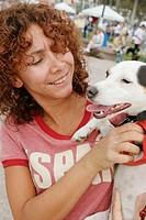 Dog, Hispanic female owner. Walk for the Animals, Humane Society event, Bayfront Park, Miami, Florida. USA.