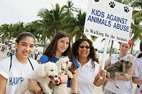 Kids Against Animal Abuse, teens and dogs. Walk for the Animals, Humane Society event, Bayfront Park, Miami, Florida. USA.