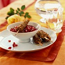 Chicken breast kebabs with nut crust and pomegranate sauce