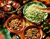 Two Bowls of Chili con Carne and a Bowl of Green Pepper Rice