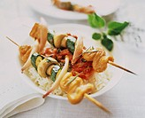 Kebabs with turkey and vegetables on rice
