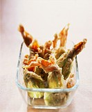 Deep-fried stuffed courgette flowers