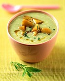Creamed cucumber and mint soup with curried potatoes