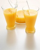 Concentrated orange juice in glasses