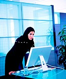 Arab businesswoman at desk with computer