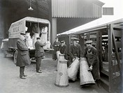 Photograph showing the loading of the Milk Train with milk delivered by Viner & Long.