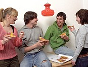 Teenagers sharing a pizza
