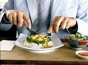 detail of man eating asian food