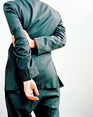 Businessman with hands behind back
