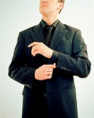 Businessman adjusting sleeve (thumbnail)