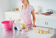 Woman preparing to make biscuits