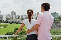 Couple on balcony looking at view