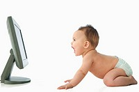 Baby looking at computer monitor