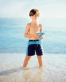 Boy standing in the sea