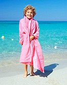 Boy wrapped in a pink towel