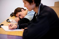 Student resting his head on desk