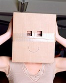 Woman wearing a cardboard box on head