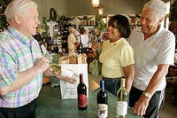 Winery tasting room, gift shop, Black couple. Morgan Creek Vineyards, Harpersville, Alabama. USA.