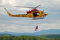 CH-148 Griffon helicopter (Canadian Forces) during a Search and Rescue (SAR) demonstration at airshow. Bagotville military base, Quebec, Canada