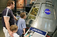 Father, sons, Mercury Project simulator exhibit. U.S. Space and Rocket Center. Huntsville. Alabama. USA.