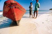 Bajau (sea gypsy) boys take a break from fishing in the tropical seas of Wakatobi Marine Park, Hoga Island, Sulawesi, Indonesia