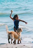 little girl and dogon bau beach, fregene, lazio, italy