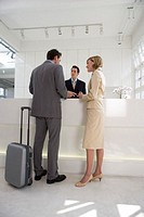 business couple talking at reception in office building
