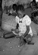 African girl playing Guinea-Bissau 1994