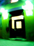 Blurred green door of a Lower East Side tenement building in New York City. Otherworldly feel, very spaced out. USA