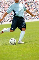 Soccer player striking ball (thumbnail)