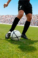 Soccer player striking ball