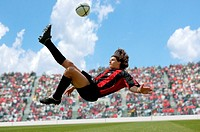 Soccer player doing scissor-kick (thumbnail)