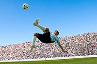 Soccer player doing scissor-kick