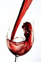 Red wine pouring into glas