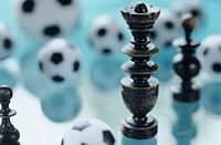 Chessman and football toys