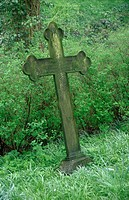 Metallic cross on grave