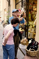 Tourists at a food shop, Lucca. Tuscany, Italy