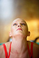 Caucasian Woman with alopecia areata/cancer survivor working out at the gym