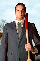 Businessman holding baseball bat