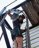 Female diver climbing ladder