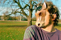 Man wearing horse mask