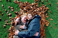 Couple sleeping on leaves