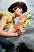Woman playing with toy guns