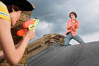 Couple playing with water pistols